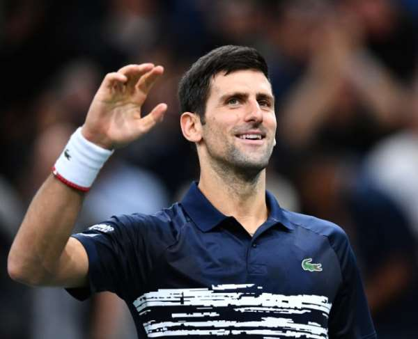 Novak Djokovic smiles on the court  Image credit: Getty Images