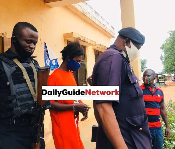 Accused person Latifah Bumaye being escorted by police at Bole District Magistrate Court