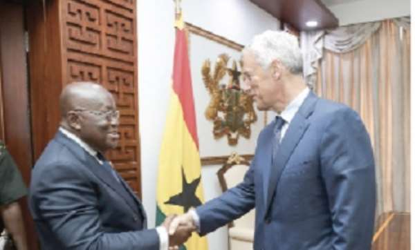 Mr Winters (right) in a handshake with President Akufo-Addo after the courtesy call at the Jubilee House