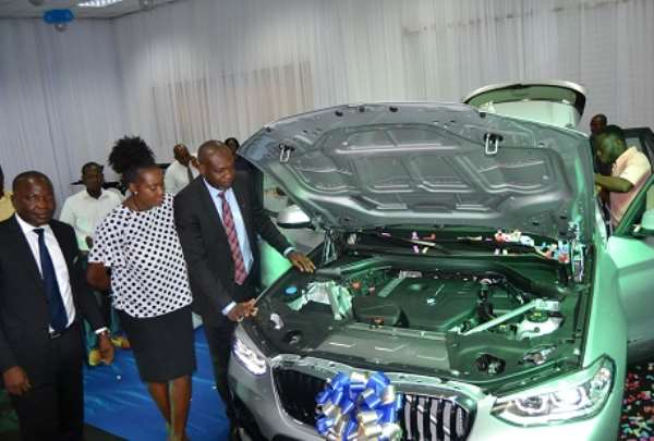 Officials inspecting the BMW X3