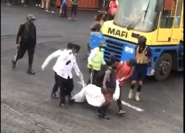 Tema port workers on rampage over death of colleague