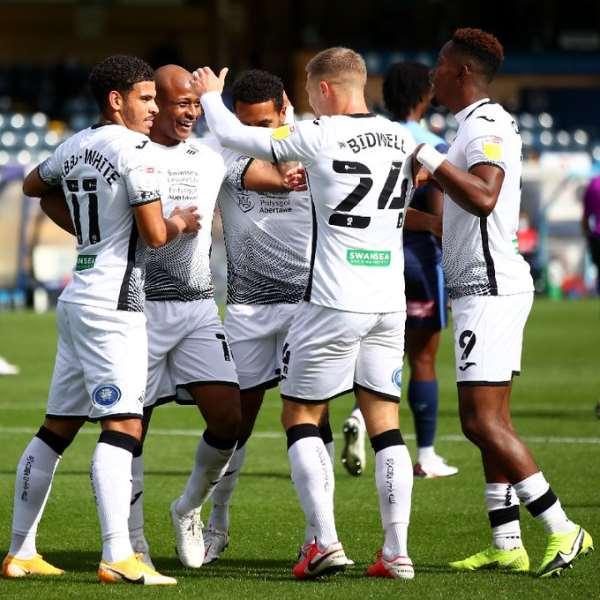 Andre Ayew celebrates with Swansea City teammates