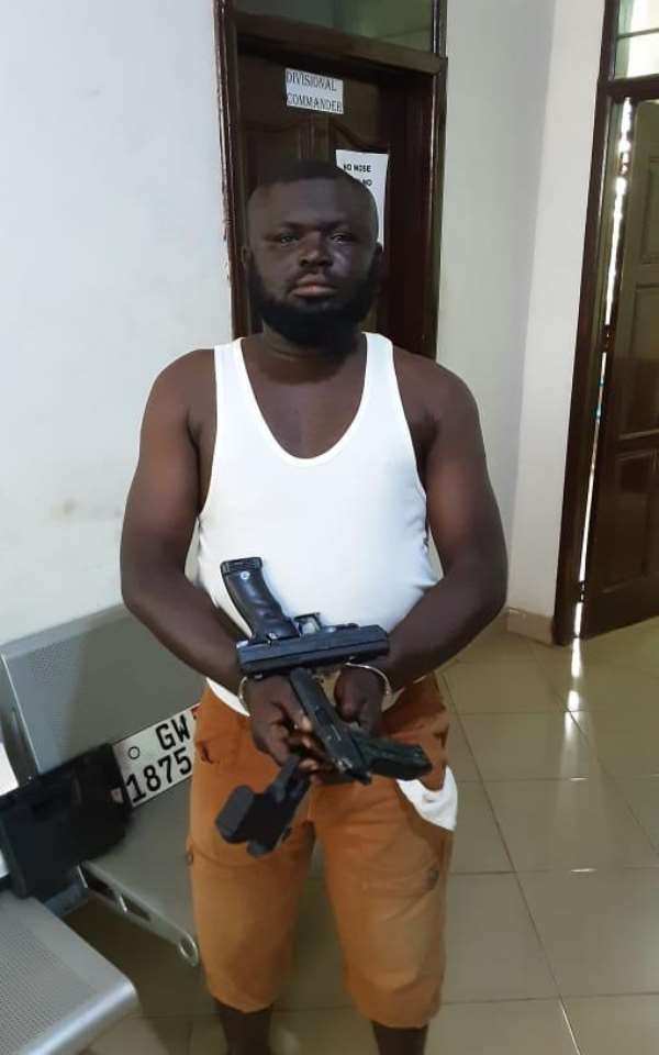 Suspect Alhassan Imrani with the weapons at the Northern Regional Police Command