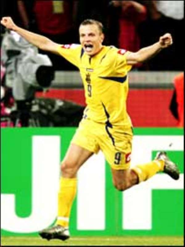 Gusev celebrates scoring the decisive penalty