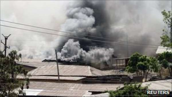 Buildings have been set ablaze in the latest clashes in Jos