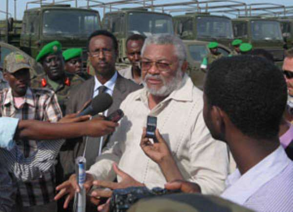 President Rawlings making his remarks at the handing over ceremony. in the background are some of the military vehicles