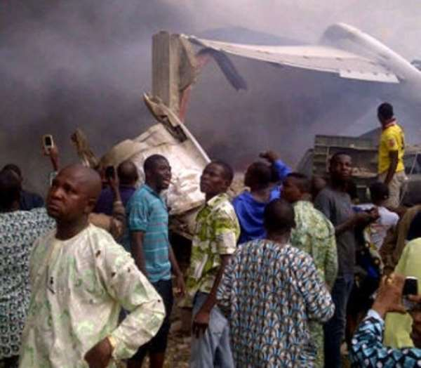 Residents of the Iju district of Lagos gathering at the site where a Dana company aircraft crashed.  By Ckn (AFP)