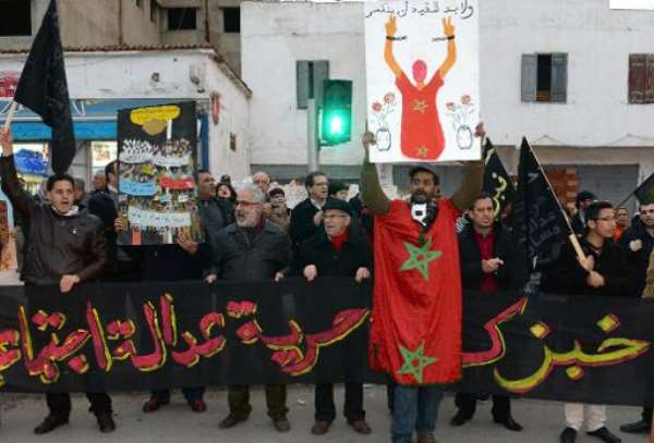 Moroccans hold placards and shout slogans as they take part in a demonstration in Rabat, organised by the pro-reform February 20 movement on February 17, 2014.  By Fadel Senna (AFP/File)