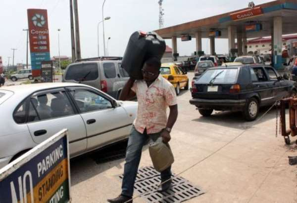 Nigerians are having to cope with petrol prices that, despite the president's compromise, remain far higher.  By Emmanuel Arewa (AFP/File)