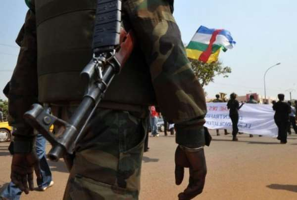A soldier ensures security during a women's march in Bangui against the current conflict, on December 28, 2012.  By Sia Kambou (AFP)