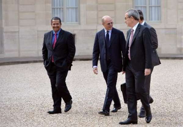 Eskom's Brian Dames (left) arrives at the Elysee Palace in Paris on June 25, 2013 for a dinner.  By Miguel Medina (AFP)
