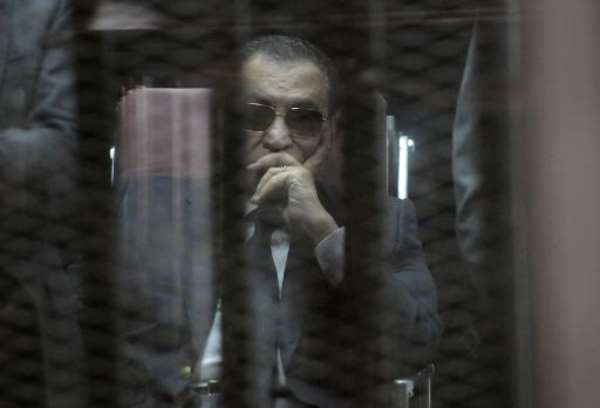 Ousted Egyptian president Hosni Mubarak sits in the defendant's cage during his verdict hearing in a retrial for embezzlement on May 9, 2015 in the capital Cairo.  By - (AFP/File)