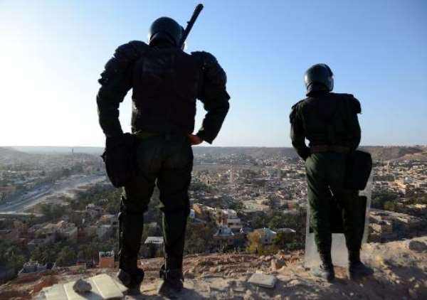 Algerian security forces stand guard on a ridge looking down on the city of Ghardaia on March 18, 2014.  By Farouk Batiche (AFP/File)