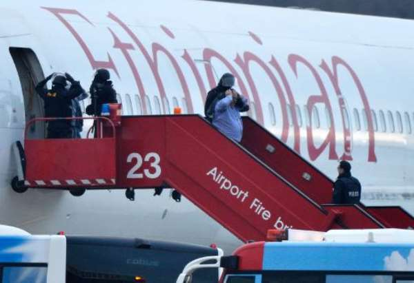Police evacuate passengers on February 17, 2014 from an Ethiopian Airlines flight en route to Rome which was hijacked and forced to land in Geneva.  By Richard Juilliart (AFP)