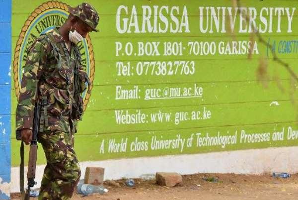A Kenyan soldier walks past the entrance of Moi University in Garissa on April 3, 2015, a day after the massacre of 148 people by Somalia's Shebab fighters.  By Carl de Souza (AFP/File)