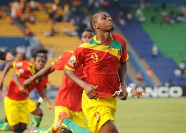 Guinea's Sadio Diallo celebrates after scoring.  By Pius Utomi Ekpei (AFP)
