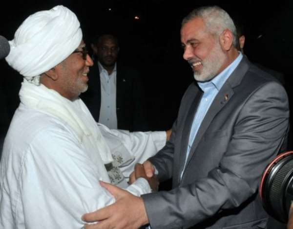 Haniya, right, was greeted at the airport by an adviser to President Omar al-Bashir.  By Ebrahim Hamid (AFP)