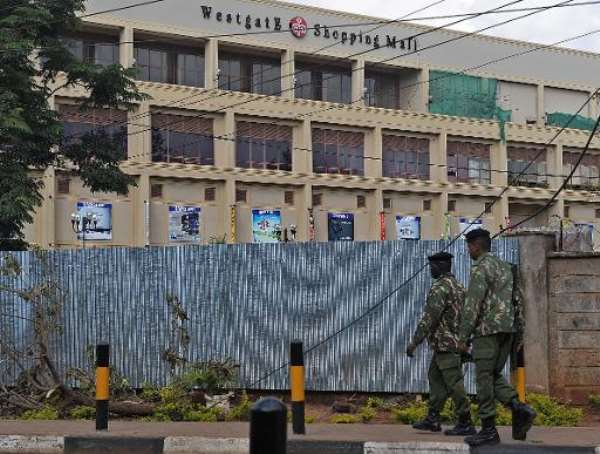 Police officers walk past the Westgate mall in Nairobi on September 28, 2013.  By Tony Karumba (AFP/File)