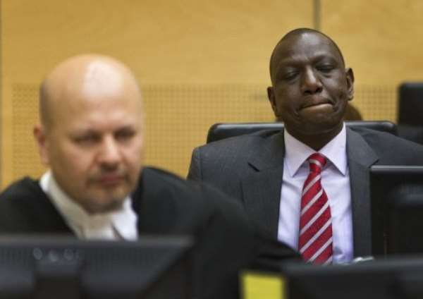 William Ruto (right) sits in the courtroom before their trial at the (ICC) in The Hague on September 10, 2013..  By Michael Kooren (Pool/AFP/File)