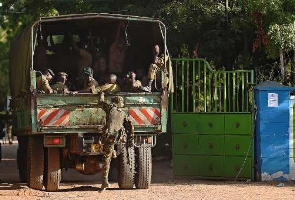 Kenya soldiers enter the Moi University campus of the northeastern town of Garissa on April 3, a day after Shebab militants killed almost 150 students.  By Carl De Souza (AFP)