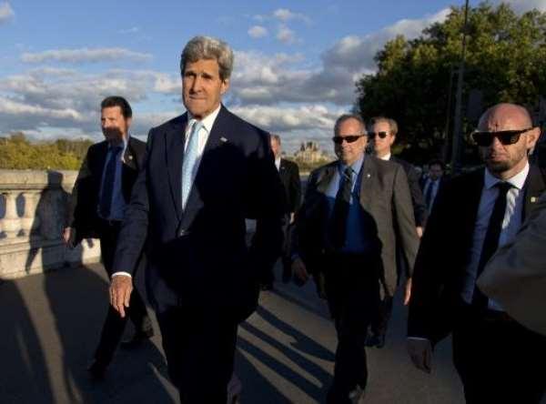 US Secretary of State John Kerry walks in Paris on October 13, 2014.  By Carolyn Kaster (Pool/AFP)