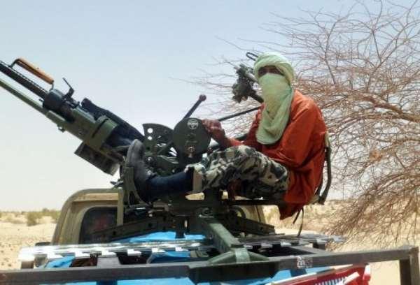 An Islamist rebel mans a gun near Timbuktu.  By Romaric Ollo Hien (AFP/File)