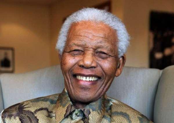 A TV clip today showed Nelson Mandela flanked by his wife Graca Machel.  By Debbie Yazbek (AFP/Mandela Foundation/File)