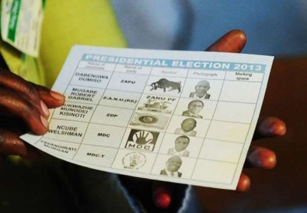 A Zimbabwean voter holds a ballot paper at a polling station in Domboshava, on July 31, 2013.  By Alexander Joe (AFP/File)