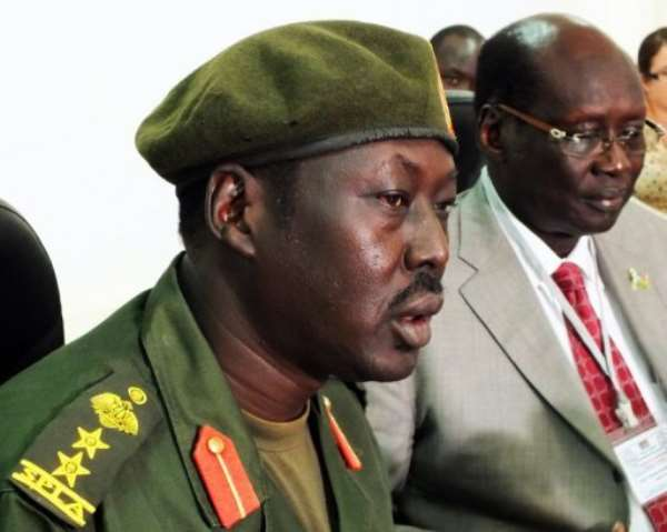 SPLA spokesman Colonel Philip Aguer (L) and South Sudan government spokesman Barnaba Marial Benjamin.  By Waakhe Wudy (AFP)