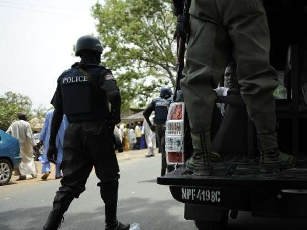 Nigerian police detain suspicious people near a polling station during a security operation to stave ballot box-snatching in Bauchi, Nigeria on April 28, 2011.  By Tony Karumba (AFP/File)
