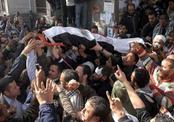 Mourners carry the body of a protester killed in clashes with security forces in Cairo.  By Khaled Desouki (AFP)