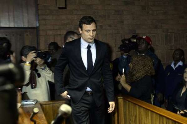 Oscar Pistorius arrives at the Magistrate Court in Pretoria on August 19, 2013.  By Stephane de Sakutin (AFP/File)