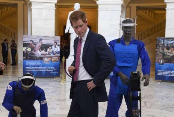 Prince Harry tours an exhibit on landmines and unexploded ordnances in Washington, DC, on May 9, 2013.  By Jewel Samad (AFP/File)