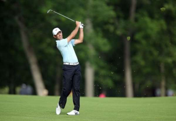 Charl Schwartzel of South Africa hits his second shot on the par 4 13th hole on May 30, 2013, in Dublin, Ohio.  By Andy Lyons (Getty Images/AFP)