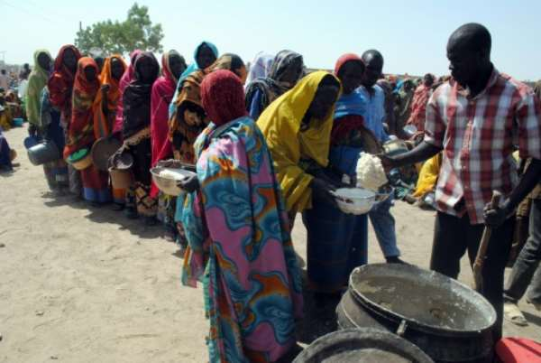 Internally Displaced People queue to be served with food at Dikwa Camp in Borno State in north-eastern Nigeria on February 2, 2016.  By  (AFP/File)