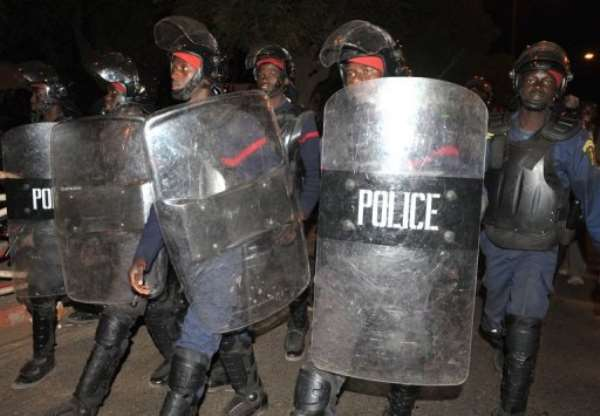 Police block youths in Dakar on Tuesday night.  By Seyllou (AFP/File)