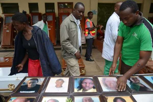 Relatives look at portraits of students killed in last week's attack on the Garissa University campus by Somalia's al-Qaeda-linked Shebab insurgents, at the Chiromo morgue, on April 9, 2015 in Nairobi.  By Simon Maina (AFP)