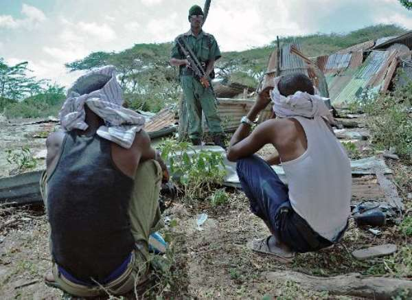 Suspected Al-Shebab members are detained by Somali security forces during an operation in Mogadishu on December 8, 2014.  By Mohamed Abdiwahab (AFP/File)
