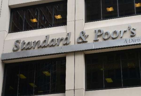 Standard and Poor's credit rating agency downgraded Nigeria by a notch to B+ from BB-.  By Emmanuel Dunand (AFP/File)