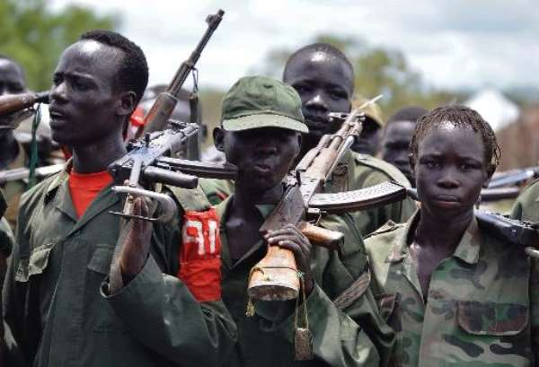 Young members of the South Sudan Democratic Movement/Army (SSDM/A) faction march in Gumuruk, Sudan on May 13, 2014.  By Samir Bol (AFP/File)