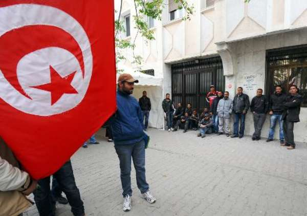 File photo for illustration shows unemployed men blocking the access to the Labour Ministry headquarters in Tunis on April 20, 2012.  By Fethi Belaid (AFP/File)