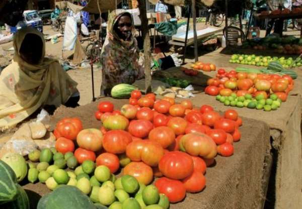 Sudanese women sell vegetables at the market in Khartoum.  By Ashraf Shazly (AFP/File)