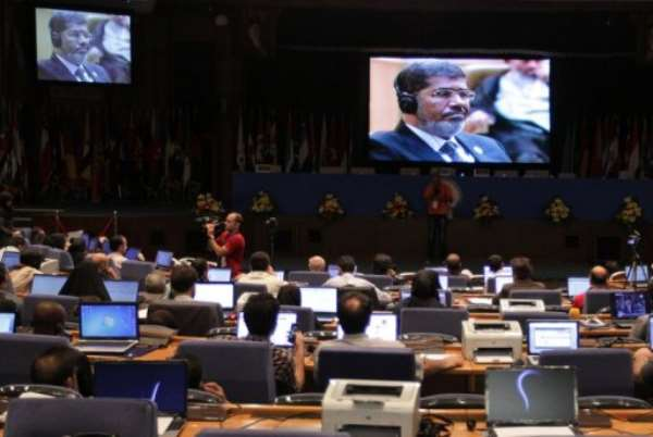 The Syrian delegation walked out during Mohamed Morsi's speech (seen on the screen as he attends the summit in Tehran).  By Behrouz Mehri (AFP)