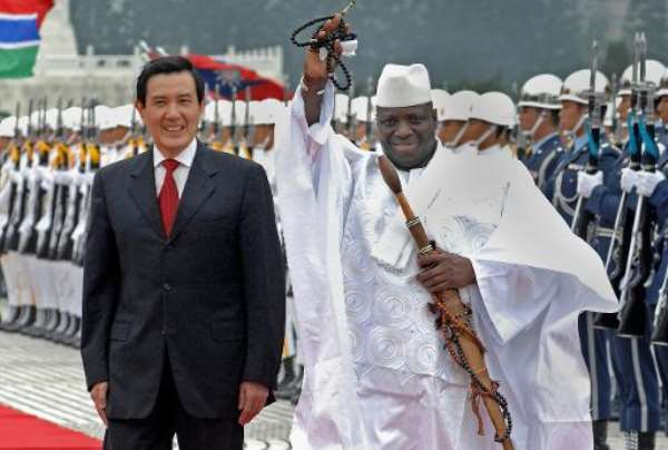 In this file photo, visiting Gambian President Yahya Jammeh (R) is seen being accompanied by his Taiwanese counterpart Ma Ying-jeou, during a welcoming ceremony in Taipei, on April 21, 2009.  By Patrick Lin (AFP/File)