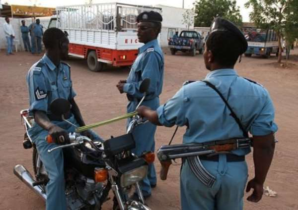 Sudanese police officers stand guard in Khartoum in 2010.  By Patrick Baz (AFP/File)