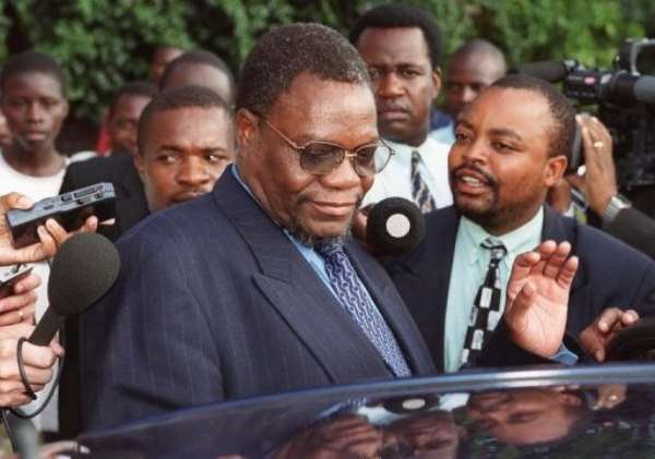 Zimbabwe's then Minister of Land and Agriculture Kumbirai Kangai leaves Harare Magistrates Court March 21, 2000.  By  (AFP/File)