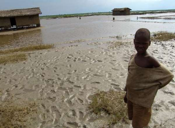 A displaced Burundian boy stands outside houses destroyed by floods at Gatumba, near Bujumbura on January 25, 2007.  By Wfp (World Food Programme/AFP/File)