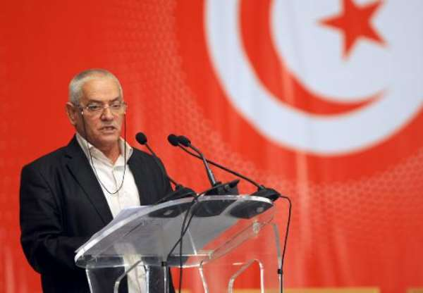 Houcine Abbassi, head of the Tunisian General Labour Union (UGTT), speaks at a conference on May 16, 2013 in Tunis.  By Fethi Belaid (AFP/File)