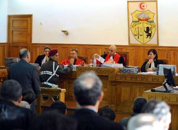 Tunisian former director general of the intervention brigade, Jalel Boudriga (L), answers questions in front of magistrates at a military court on January 3, 2012 in Tunis.  By Fethi Belaid (AFP/File)