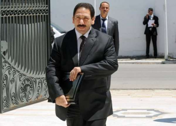 Tunisian Interior Minister Lotfi Ben Jeddou (C) arrives at the Prime Minister's office in Cathage on August 3, 2013.  By Fethi Belaid (AFP/File)